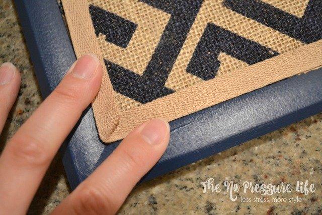 Adding ribbon trim to a cork board