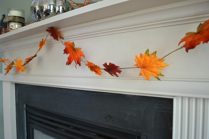 This DIY Fall Leaf Garland Tutorial takes just a few minutes and adds great color to your fall mantel decor! | The No Pressure Life
