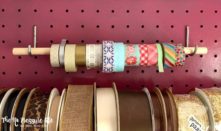 Hang a dowel on a pegboard to store washi tape. | The No Pressure Life