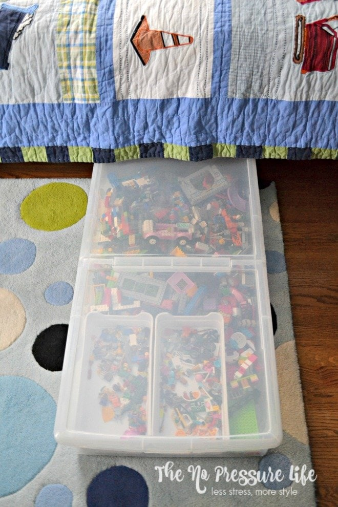 LEGO organization in a boys bedroom under the bed
