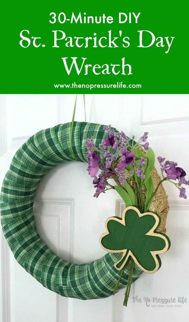 DIY St. Patrick's Day wreath decorated with green plaid ribbon and a wood shamrock