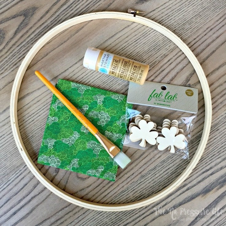 supplies to make an easy shamrock craft for St. Patrick's Day