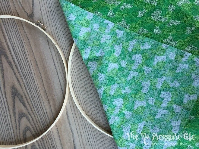 embroidery hoop with green fabric for shamrock craft