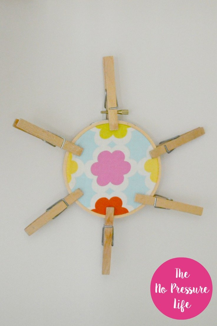 Easy laundry room decoration: cute clothespin craft! See more of this small laundry closet makeover at The No Pressure Life.