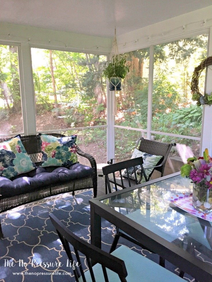 Budget-friendly decorating ideas for a small screened-in porch.