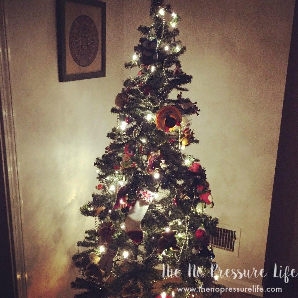 Easy Elf on the Shelf Ideas: hiding in the Christmas tree