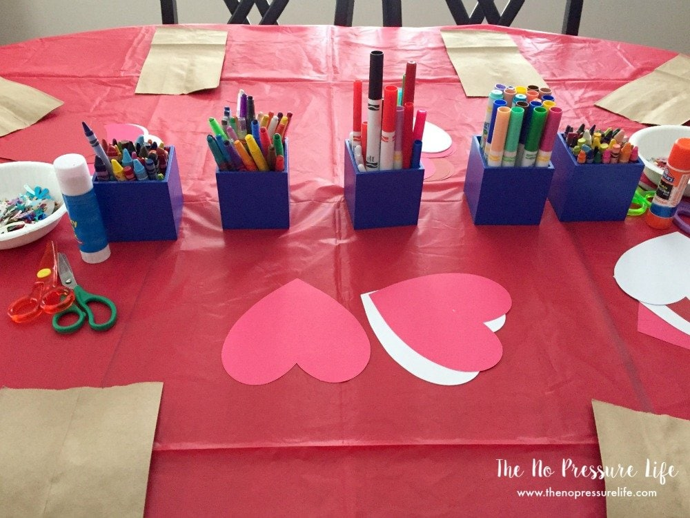 Valentine's Day party for kids - craft project to decorate bags for cards.