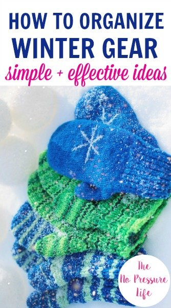 Organizing winter gear article - blue and green mittens on snow.