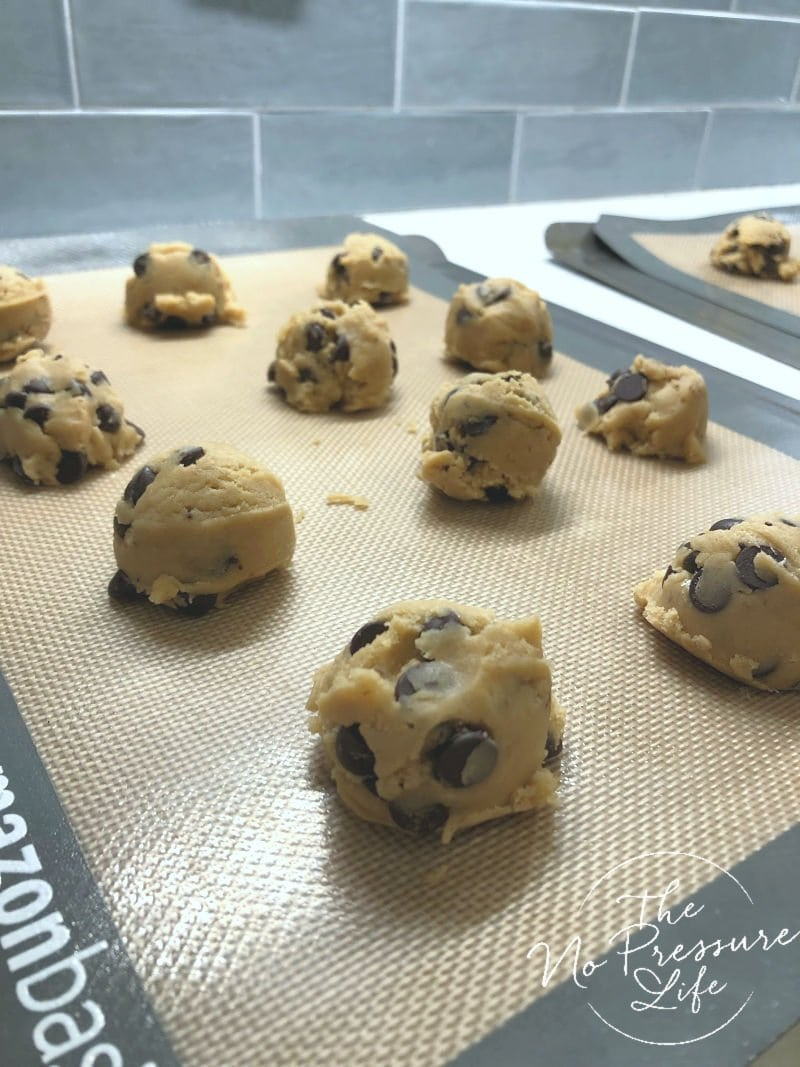 chocolate chip cookie dough on baking sheet