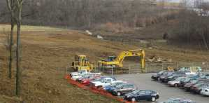 Weather, parking slowed field construction