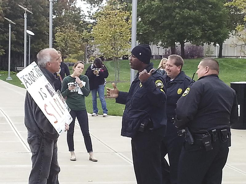 Campus+police+inform+abortion+protestor+that+he+needs+to+relocate+to+a+free+speech+zone+on+campus.