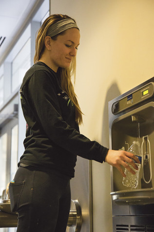 Senior BFA drawing major Denise Wellbrock refills her water bottle at a filling station in the Student Union.