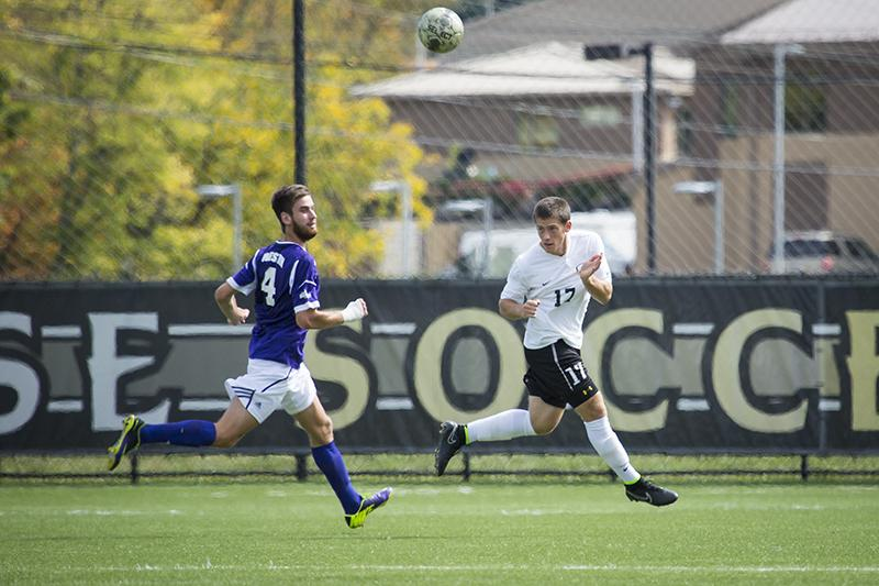 NKU's Christian Johnson heads the ball during NKU's loss to Western Illinois. NKU lost 2-0 to Western Illinois on Sunday, Sept. 28, 2014 at NKU Soccer Stadium.