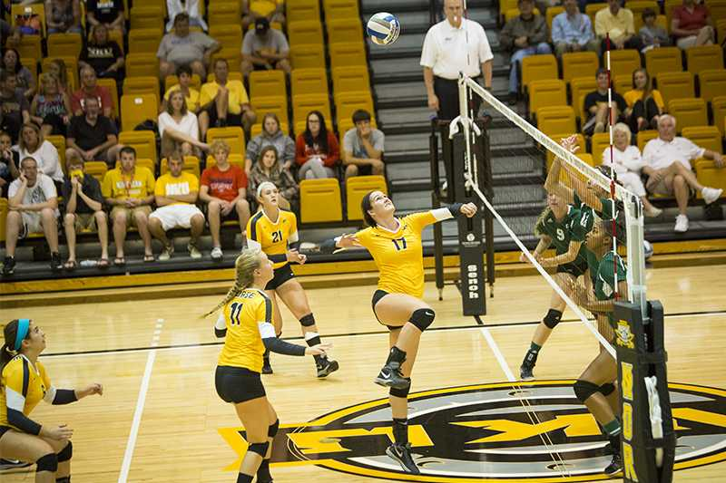 NKU+middle+hitter+Jenna+Ruble+jumps+to+hit+the+ball+over+the+net+during+NKU%27s+3-0+loss+to+Eastern+Michigan.+NKU+lost+to+Eastern+Michigan+on+Saturday%2C+Sept.+6%2C+2014+at+Regent+Hall+in+the+inaugural+Northern+Kentucky+Volleyball+Invitational+and+finished+2-1+in+the+tournament.+