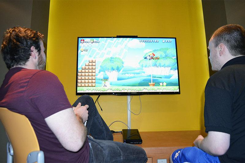 Two+students+play+Super+Smash+Bros.+U+in+the+game+room+at+NKU.+