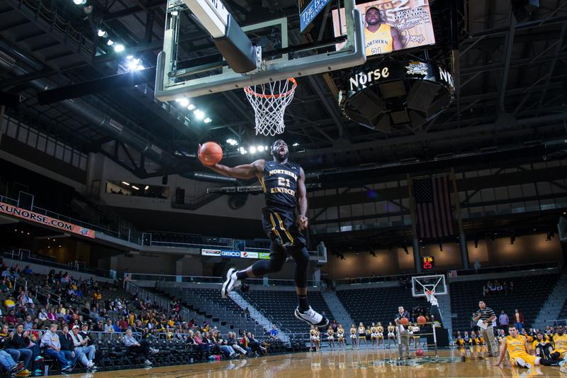 NKU+men%27s+basketball+player+Jalen+Billups+goes+up+for+the+dunk%2C+finishing+4th+in+the+NKU+Dunk+Contest+at+Black+and+Gold+Madness.+NKU%27s+2014+Black+and+Gold+Madness+was+held+at+the+Bank+of+Kentucky+Center+on+October+9%2C+2014+celebrating+the+start+of+the+2014-15+season.