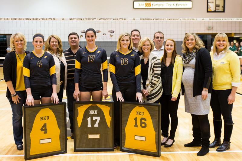 NKU+seniors%2C+Kiersten+Ham+%284%29%2C+Jenna+Ruble+%2817%29+and+Megan+Wanstrath+%2816%29++celebrate+their+Senior+Day+with+their+families+and+coaches.+NKU+defeated+USC+Upstate+3-1+on+Saturday%2C+Nov.+15%2C+2014+in+Regents+Hall+on+NKU+campus.