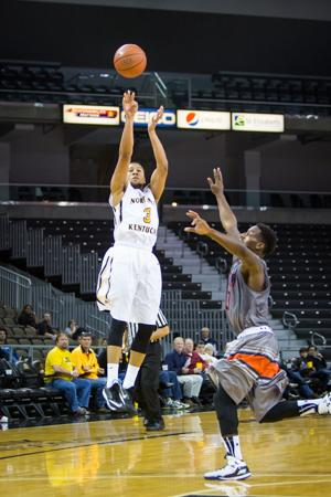 NKU player Tyler White shoots the ball against UT Martin in the second half of NKU's 56-71 loss. NKU lost to UT Martin 56-71 at The Bank of Kentucky Center on December 3, 2014.
