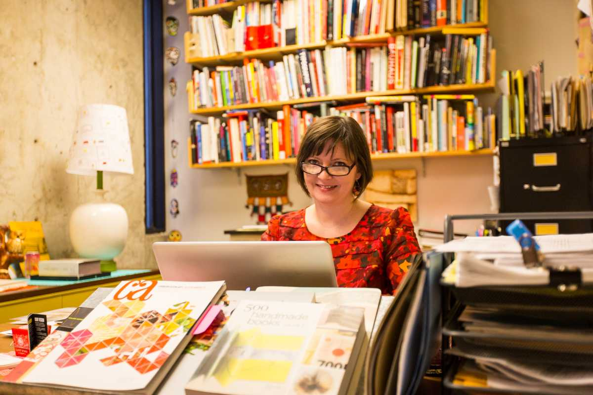 Julie Mader-Meersman sits in her colorful office. Her office is the fourth office in The Northerner's Top Offices.