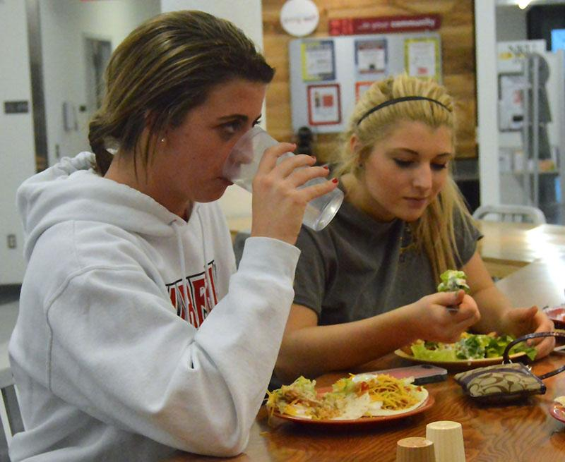 Freshmen Macy Hamblin and Morgan Shafer enjoy a meal at The Village Café in Norse Commons. Vegetarian, gluten-free, and Healthy U options are offered every day.