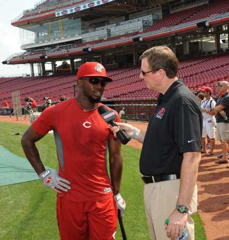 "NKU and Cincinnati Reds broadcaster Jim Kelch talks to a Reds player before a game. Kelch is the ""Voice of the Norse"" for NKU men's basketball radio broadcasts. Photo provided by the Cincinnati Reds."
