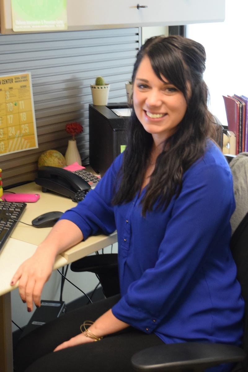 Gabby Molony sits at her desk. Molony is the Norse Violence Prevention coordinator.