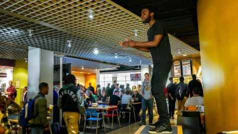 Charles Williams stood on a table near Coyote Jack's. On November 21 there will be a 'student talk' in the inclusive center for minority and majority students alike to come together in open conversation.