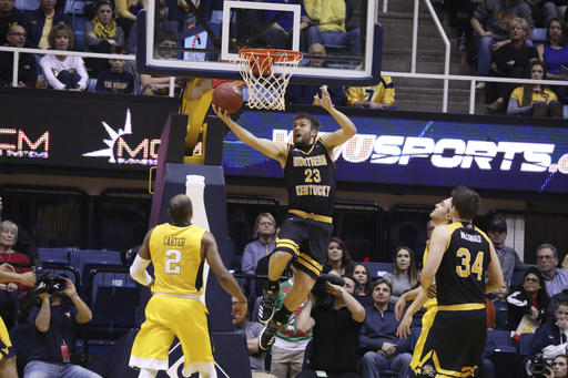 Northern Kentucky forward Carson Williams (23) drives to the basket during the first half of an NCAA college basketball game against West Virginia, Friday, Dec. 23, 2016, in Morgantown, W.Va. (AP Photo/Raymond Thompson)