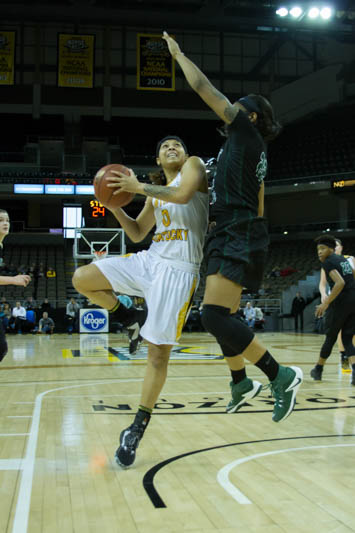 Shar'Rae Davis attempts to jump around a Wright State defender.