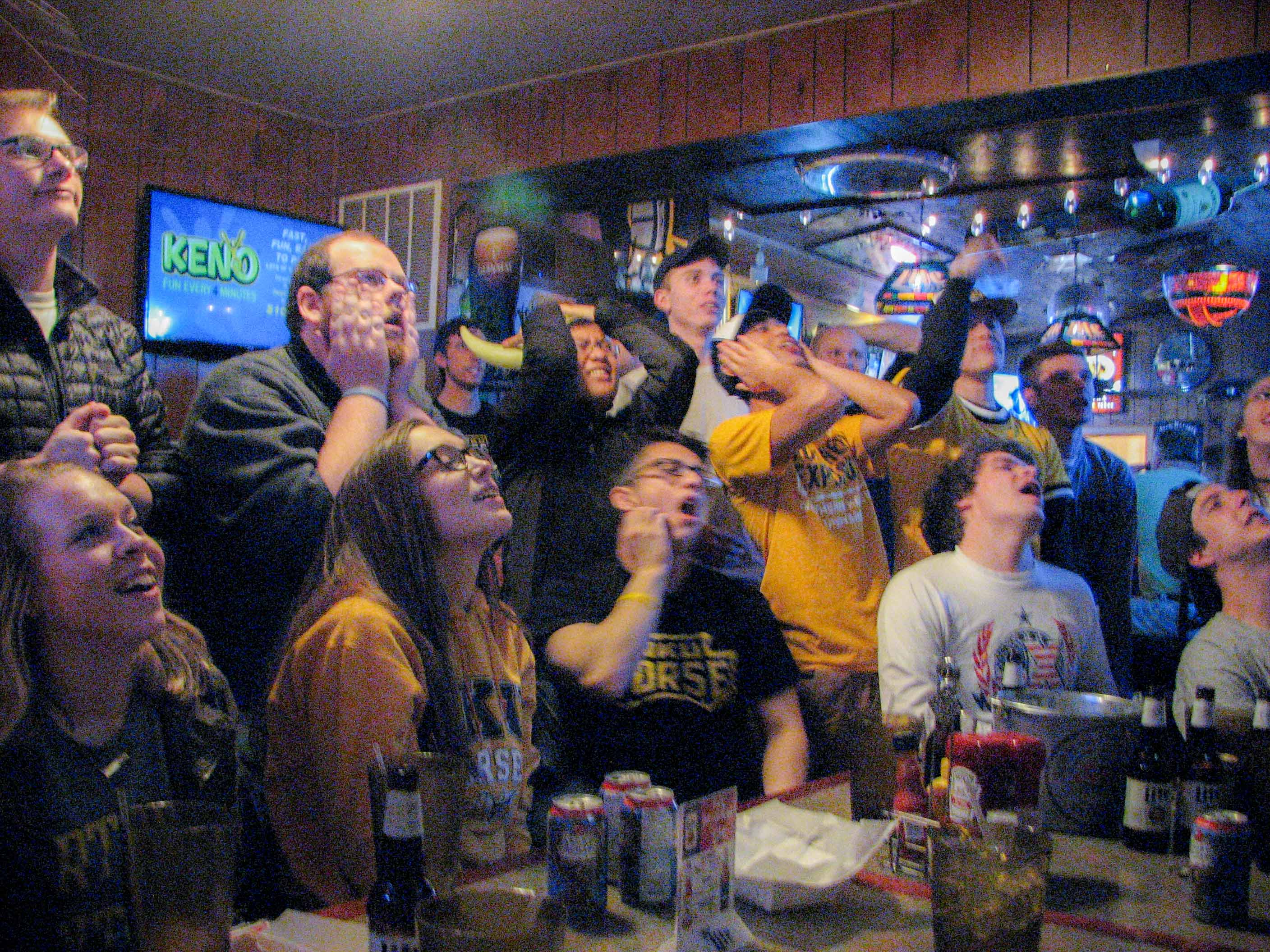 The crowd at Skyline Tavern rooted on the Norse against Milwaukee during the Horizon League tournament championship game.