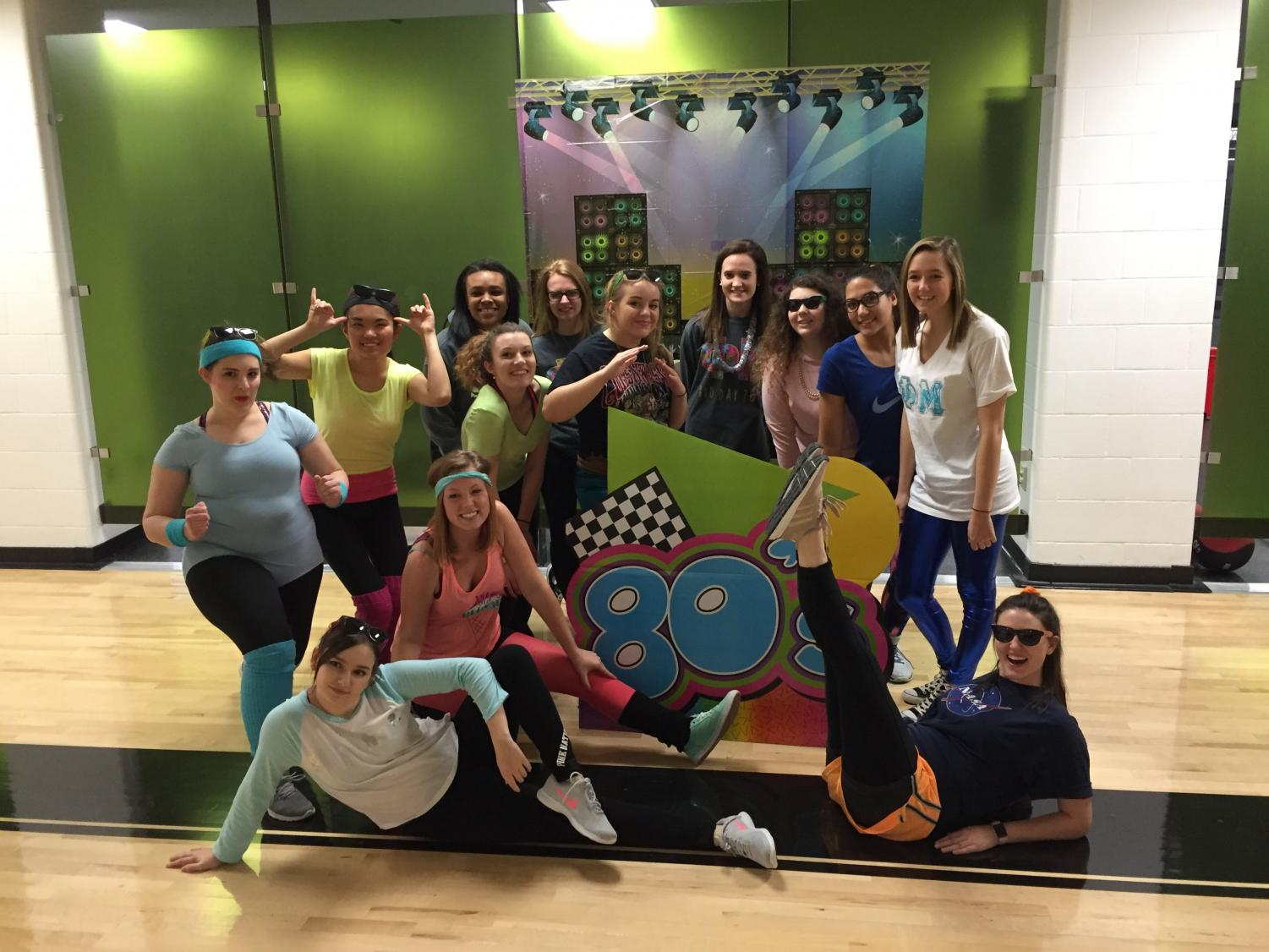 Neon-clad students waxed (and flexed) nostalgic at an 80's Aerobics session.