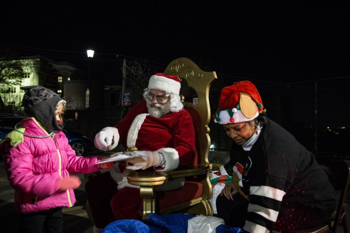 A child visits Santa and his elf during Light Up Night 2017 in Observatory Hill. Photo credit: Chloe Jakiela