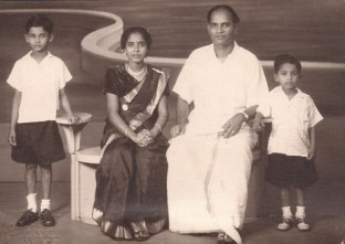 Mano with his younger brother, father and mother in 1951