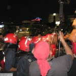 The Light Strike Unit closed in on protesters as the organisers demanded that the police allow them to continue with the vigil. Protesters abruptly burst into a rendition of 'Negaraku' as police persisted for the group to disperse.