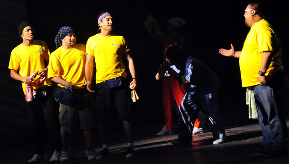 In their signature yellow T-shirts in Cuci the Musical, from left, actors Nabil, Awie, Isaac and Afdlin Shauki