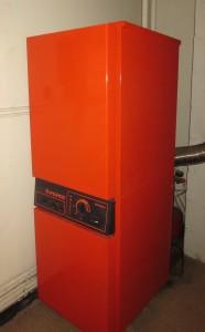 The orange oil-burning behemoth installed now.