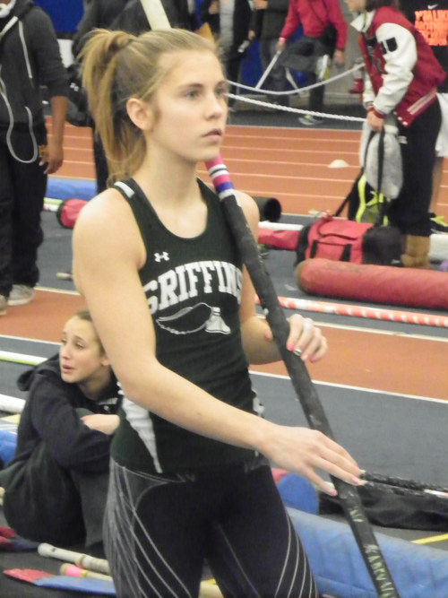 "Photos by Jim Hague Sophomore Katherine ""Kas"" Rozalski mentally prepares for her chance in the pole vault at the Bennett Center in Toms River, where she finished sixth overall in the entire state."