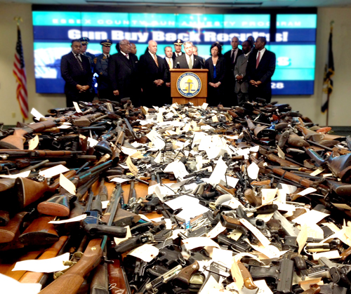 Photo courtesy Office of N.J. Attorney General Law enforcement authorities display weapons collected at Newark press conference.