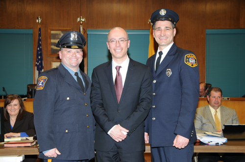 Photo courtesy of the KFD Mayor Alberto Santos congratulates newly promoted Kearny Police Sgt. Michael Ryan (l.) and Kearny Fire Capt. John DeGiovanni.