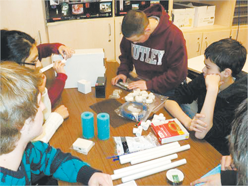 Photo courtesy of Ken Bania Students prepare to assemble their ROV.