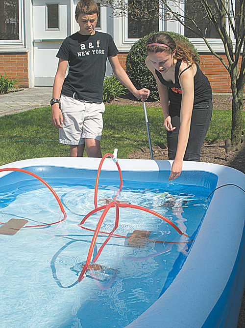 Photo by Ron Leir Students experiment with maneuvering ROV at NHS koi pool.