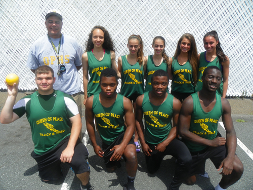 Photo by Jim Hague The Queen of Peace contingent got together before competing last week at the NJSIAA Meet of Champions in South Plainfield. Front row, from l., are Andrew Gonzales, Keith Momnohin, Kevin Momnohin and Michael Akanbi. Back from l., are head coach Nick Mazzolla, Natalie Negroni, Michele Mastrofillippo, Michaela Mastrofillippo, Melanie Zaros and Lia Rodriguez. .