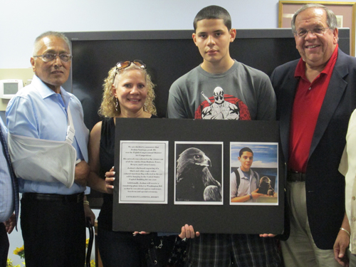 Photos by Ron Leir Harrison's Josh Santiago displays his art project that captured first place in a Congressional art competition.