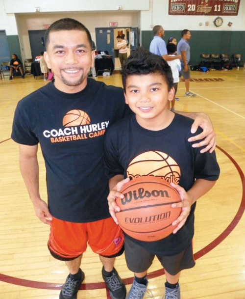 Photo by Jim Hague Julius David Sr. and his 12-year-old son, Julius Jr. of Kearny were part of the Hoopsville Cares basketball camp that the David Sr. organized.