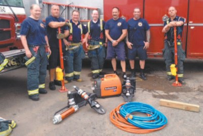 Photos courtesy Harrison Fire Department Firefighters display rescue tools.