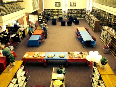 Photos by Anthony Coelho Adele Puccio takes stock of her new surroundings at Bloomfield Public Library.