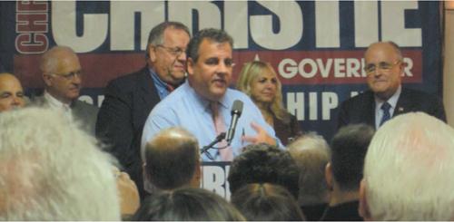 Photo by Ron Leir Gov. Chris Christie (c.) with Harrison Mayor Ray McDonough behind him and former N.Y.C. Mayor Rudy Giuliani, far right.