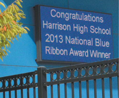 "The sign tells the story: Harrison High gets ""Blue Ribbon"" designation."