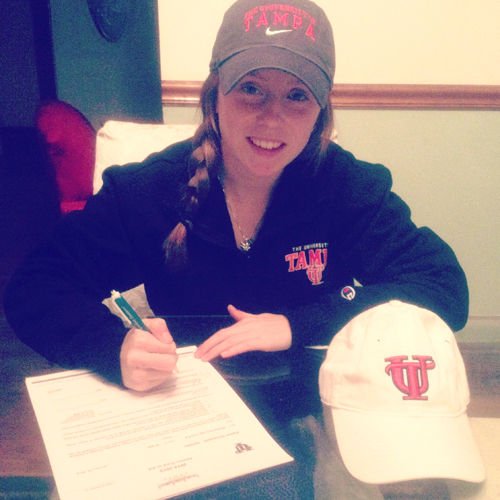 Photo courtesy the Sroczynski family Kearny High School senior Aislinn Sroczynski is all smiles after signing her national letter of intent to attend the University of Tampa on a track scholarship.