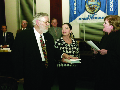 Photo courtesy Town of Harrison As his wife Linda holds the Bible, James Fife is sworn in as interim mayor by Municipal Court Judge Elizabeth McNamara.